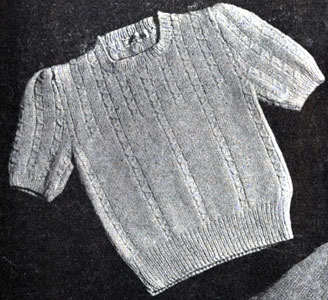 Girl's Sweater with Drawn Cables Pattern